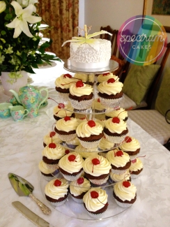 My cousin's wedding cake, She loves cupcakes and cherry pie